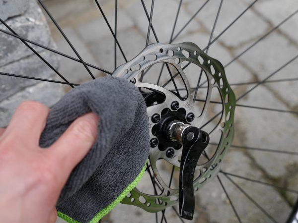 wiping-off-smurt-brake-cleaner